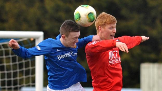 James Singleton and Chris Casement in aerial action as Glenavon beat Portadown 4-2 in the Premiership