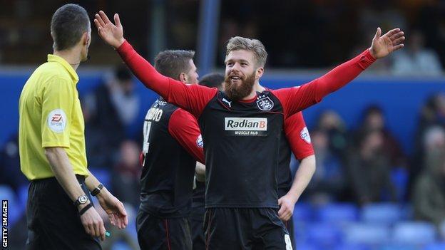Adam Clayton celebrates his goal