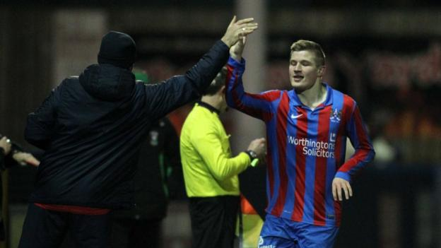 Andrew Mitchell celebrates after scoring his side's second goal in the 2-1 win over Glentoran at Clandeboye Park