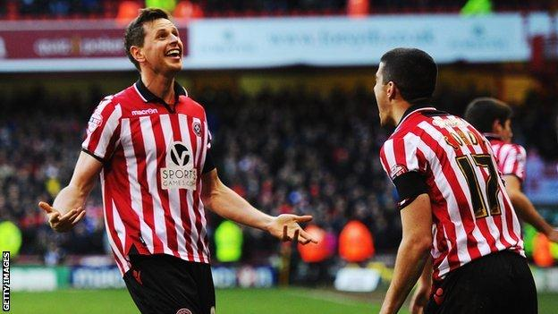 Sheffield United's Chris Porter (left) celebrates with Conor Coady as he helps his side to beat Nottingham Forest in the FA Cup