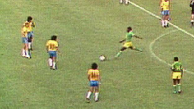 Zaire's Mwepu Ilunga kicks the ball away against Brazil