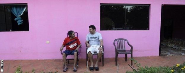Salvador Cabanas (right) with his Uncle Pablo at the family home in Itaugua, Paraguay