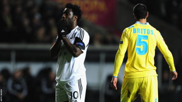 Wilfried Bony reacts to a near miss at Liberty Stadium