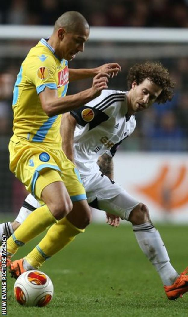 Swansea midfielder Jose Canas battles for the ball with Gokhan Inler