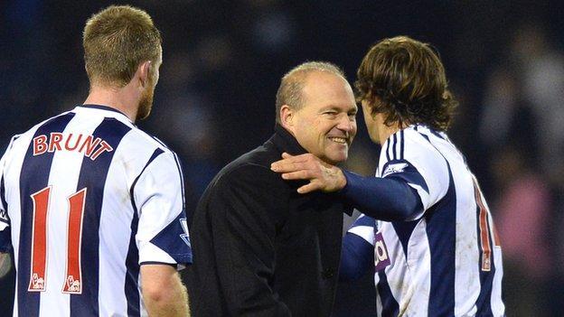 Pepe Mel (c) West Brom midfielder Chris Brunt (L) defender Diego Lugano (R)