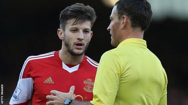 Referee Mark Clattenburg talks to Southampton's Adama Lallana during Everton's 2-1 win over the Saints