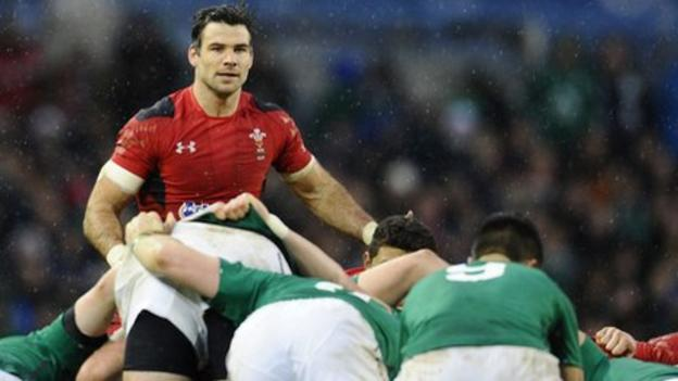 Mike Phillips looks on as Ireland's pack dominate Wales at a scrummage