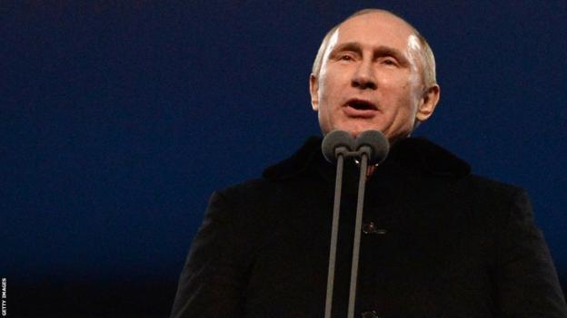 Russia's President Vladimir Putin declares the 2014 Sochi Winter Olympics open during the opening ceremony at the Fisht Olympic Stadium on February 7, 2014 in Sochi.