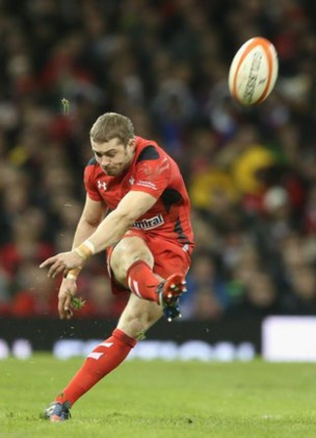 Leigh Halfpenny's five penalties, added to North's early try, give Wales a 20-6 interval lead.