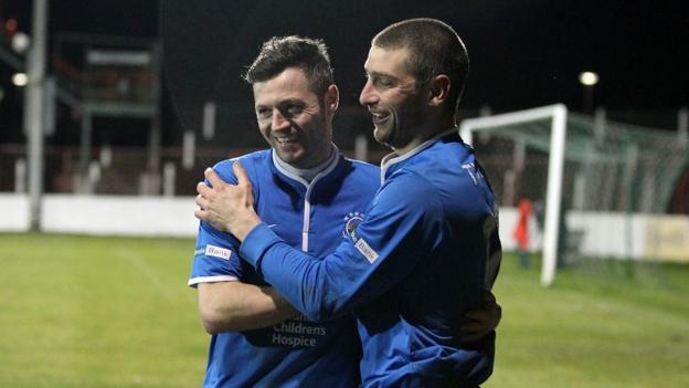Ivan Sproule congratulates Matthew Tipton after the striker scored the winning penalty against Glentoran