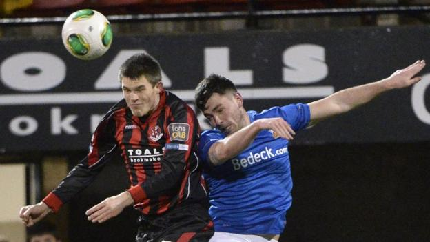 Craig McClean and Brian McCaul in aerial action during Crusaders' 2-2 draw with Glenavon at Seaview