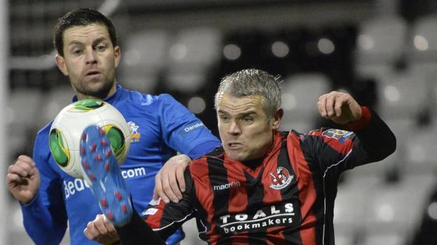 Glenavon's Eddie MccCallion challenges Gary McCutcheon of Crusaders during the Premiership match on Friday night
