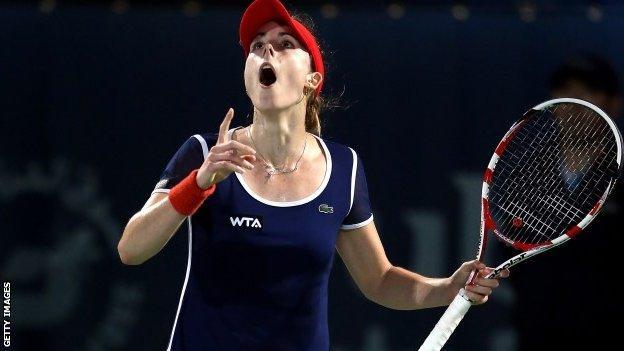 Alize Cornet celebrates her win over Serena Williams