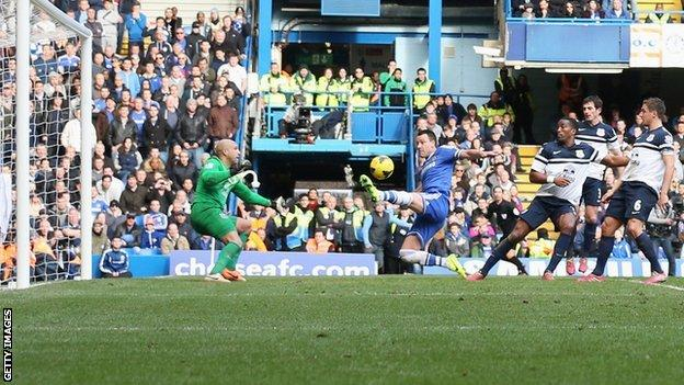 John Terry tries to get on the end of a Frank Lampard free-kick from which Chelsea scored the winner against Everton
