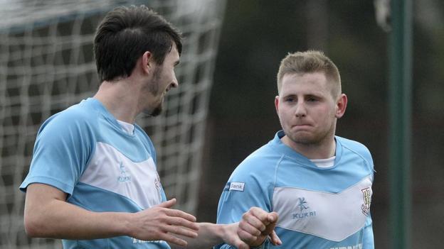 Michael McLellan congratulates Ballymena United goalscorer David Cushley