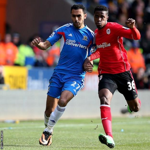 Hull's Ahmed El Mohamady battles with Wilfried Zaha of Cardiff in the Premier League at Cardiff City Stadium