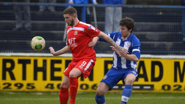 Portadown striker Darren Murray shields the ball from Coleraine defender Howard Beverland