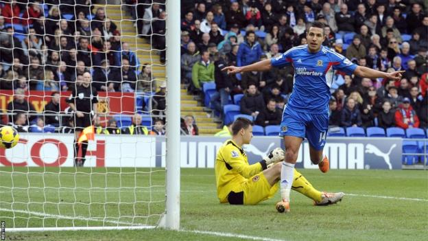 Jake Livermore wheels away after sealing a 4-0 win for Hull at Cardiff