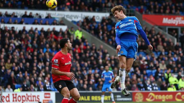 Nikica Jelavic of Hull City rises to score the second of his two goals against Cardiff