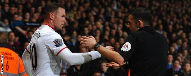 Wayne Rooney and referee Michael Oliver