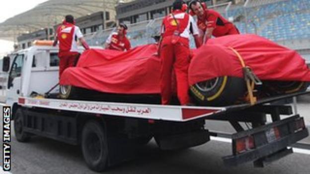 Kimi Raikkonen's car is towed away