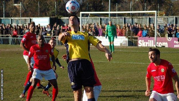 Tim Sills of Gosport Borough heads clear against Havant and Waterlooville