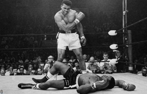 In this May 25, 1965 file photo, heavyweight boxing champion Muhammad Ali stands over fallen challenger Sonny Liston in Lewiston, Maine.