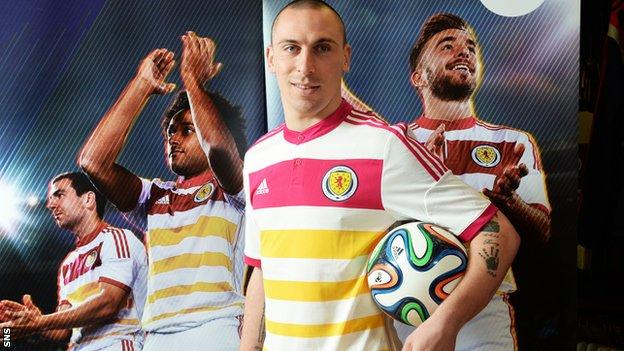 Scotland captain Scott Brown models the new away kit