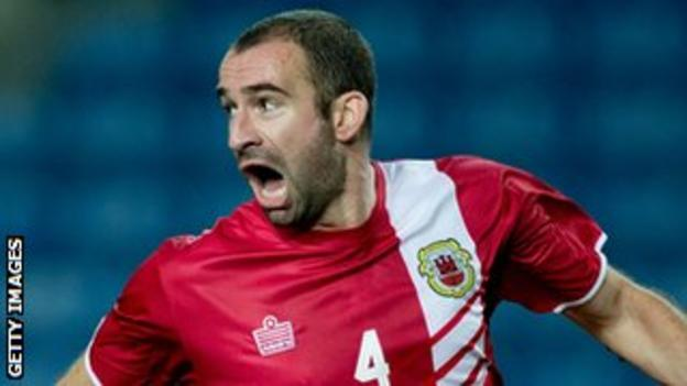 Danny Higginbotham in action against Slovakia