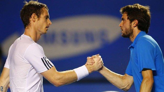 Andy Murray (left) shakes hands with Gilles Simon