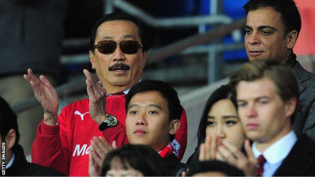 Vincent Tan in a red Cardiff City shirt