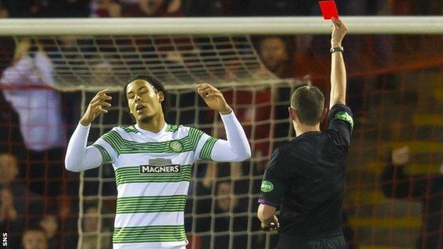 Virgil van Dijk is shown a red card by Craig Thomson
