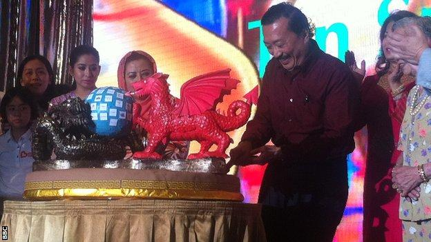 Tan cuts his birthday cake - a slightly smaller version of the 20m one he was also presented with