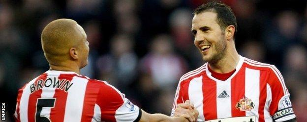 Wes Brown and John O'Shea celebrate after Sunderland's win over Manchester City in November