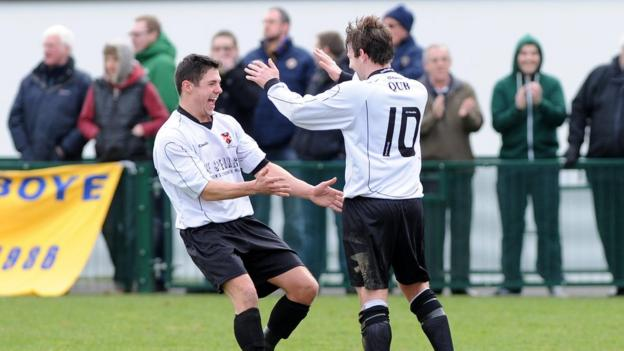 Mark Prenter is congratulated after scoring one of his two free-kick goals in Queen's University's 3-2 win over Bangor