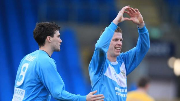 Darren Boyce celebrates the second of his two goals against Dungannon as Ballymena team-mate Gavin Taggart looks on