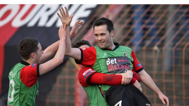 David Scullion scored a late winner for Glentoran in the sixth round replay with Armagh City at the Oval