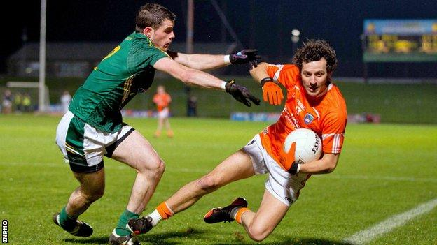 Jamie Clarke is tackled by Donal Keoghan at Pairc Tailteann