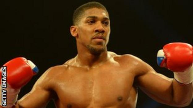 Anthony Joshua celebrates beating Hector Avila