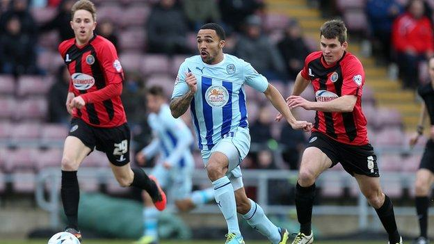 Coventry striker Callum Wilson breaks clear of the Shrewsbury defence at Sixfields