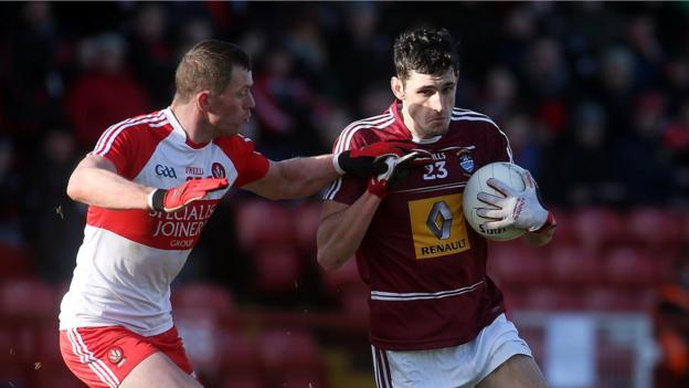 Patsy Bradley challenges David McCormick during Derry's 3-16 to 0-12 success over Westmeath on Sunday