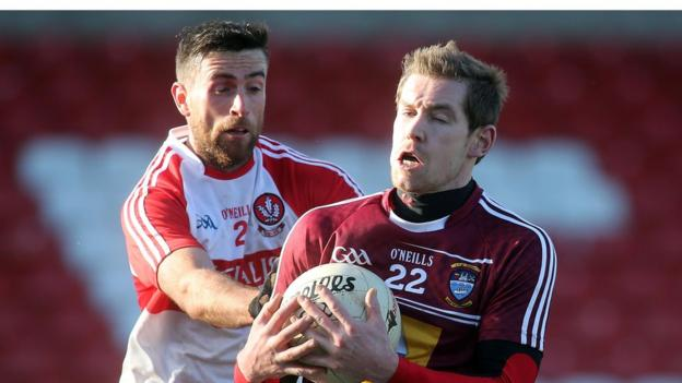 Derry's Mark Craig challenges Gavin Hoey of Westmeath for possession during the Division One game at Celtic Park