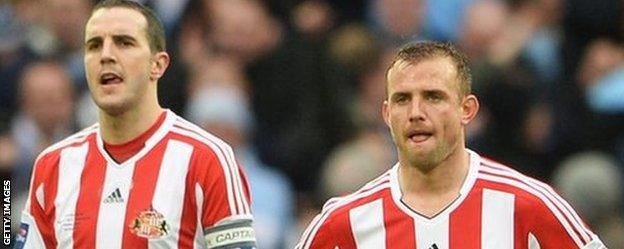 Sunderland's John O'Shea and Lee Cattermole after the Capital One Cup final with Manchester City