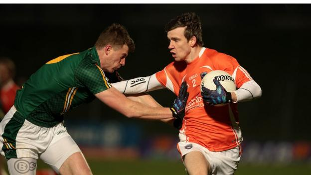 Meath's Shane O'Rourke attempts to halt the progress of Armagh's Paul Hughes as the Orchard county secure victory