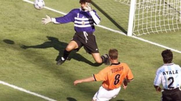 Dennis Bergkamp scores against Argentina