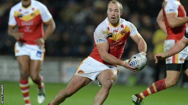 Ian Henderson of Catalan Dragons in action against Hull FC
