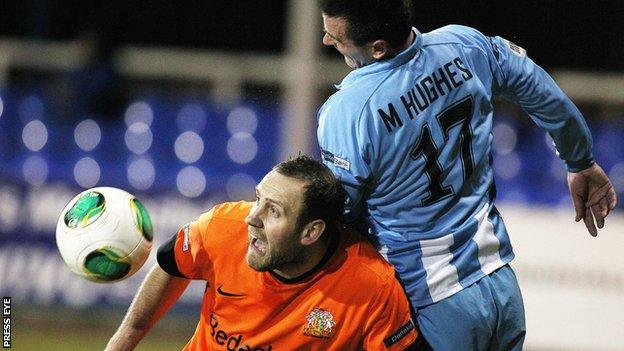Glenavon striker Guy Bates comes under pressure from Michael Hughes
