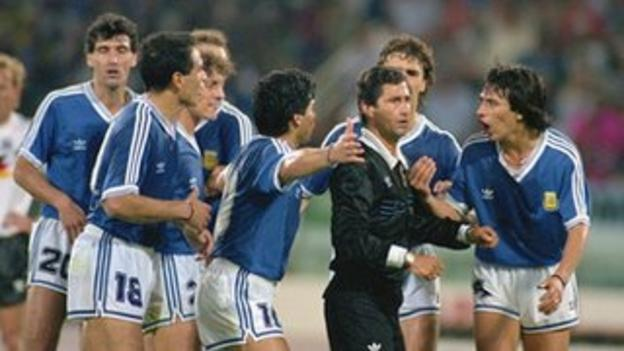 Argentina complain to referee Edgardo Codesal Mendez during the 1990 World Cup final