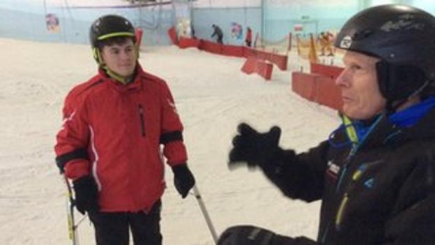 Alex Clarke is coached on the slopes by Steve Smaje