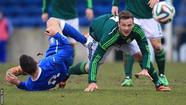Northern Ireland's Seanan Clucas battles with Federico Viviani in the Under-21 international at Mourneview Park